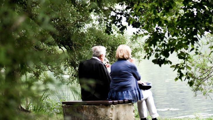 Senior Couple Sitting at the Lake